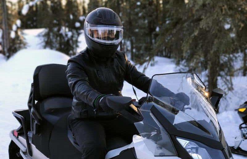 Snomobiler driving through the snow