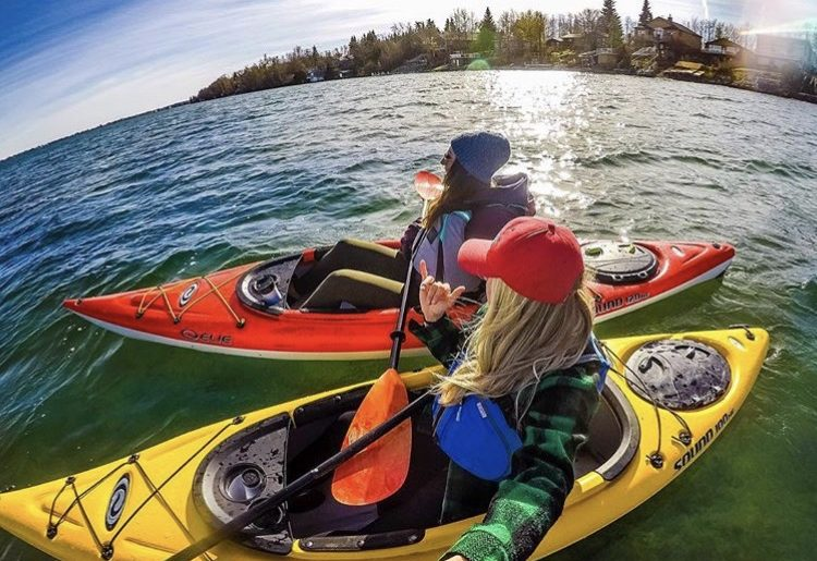 Campfire Collective Ambassador Leah Tyler-Szucki and friend taking a selfie while in their kayaks.