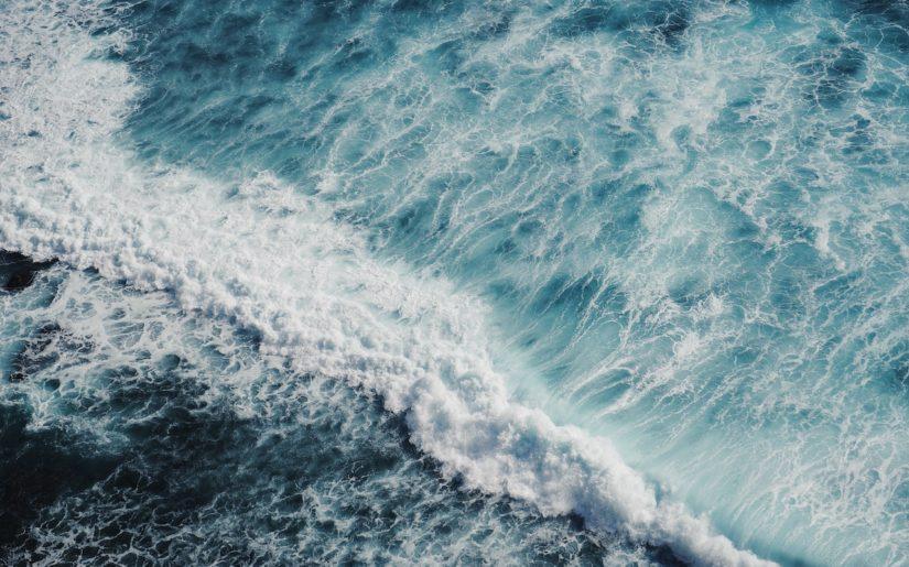 Crashing waves and rough water.