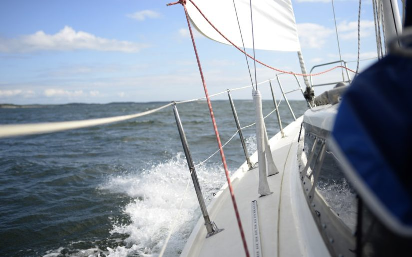 Sailboat operating at a safe speed for the wind and water conditions.