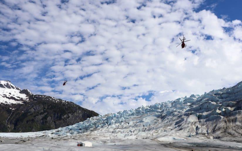 Helicopters flying over Mendenhall Glacier, Alasksa.